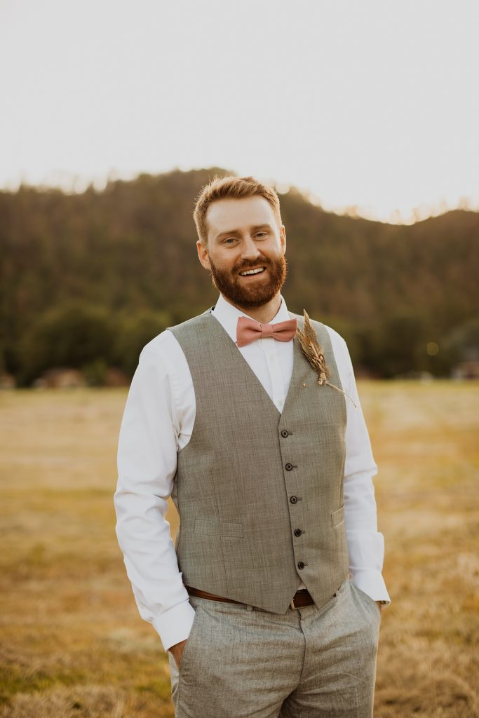 Groom Picture   Grey Suit   Blush Pink Bow Tie   Pheasant Feather Boutonniere   Cassie Madden Photography