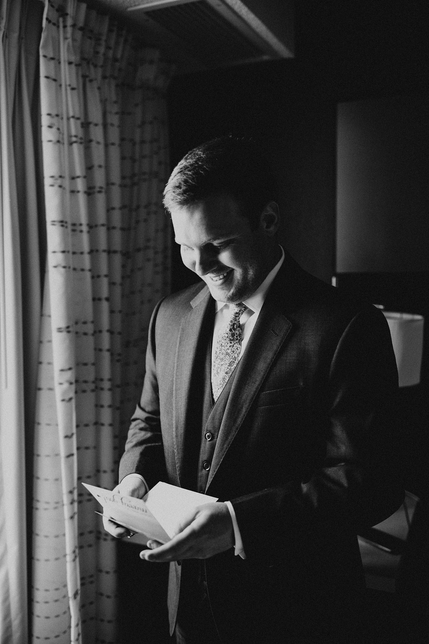 Navy Wedding Suit | Colorado Wedding | Groom Getting Ready | Groom Reading Letter Exchange | Cassie Madden Photography