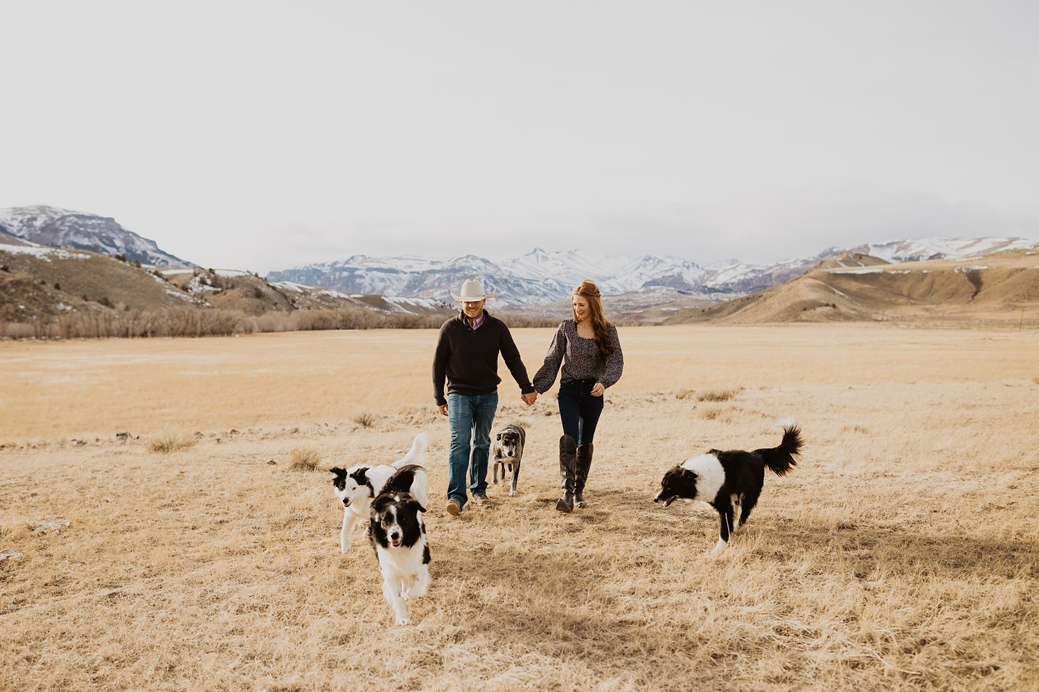 Western Engagement Photos | Wyoming Mountains | Rustic Engagement Outfits | Cowboy Wedding Inspiration | Ranch Engagement Photos | Ranch Dogs Engagement Pictures | Cassie Madden Photography